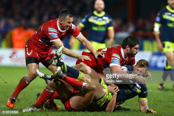 Wakefield Trinity's Kyle Wood is tackled by Hull KR's Danny McGuire Lee Jewitt and Chris Clarkson during the BetFred Super League match between Hull...