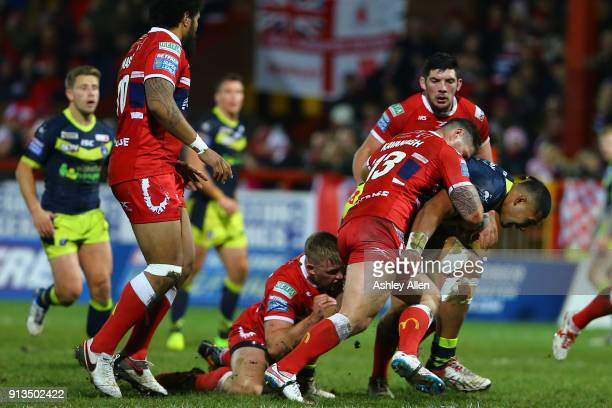 Wakefield Trinity's Reece Lyne is tackled by Hull KR's Ben Kavanagh and Matty Marsh during the BetFred Super League match between Hull KR and...