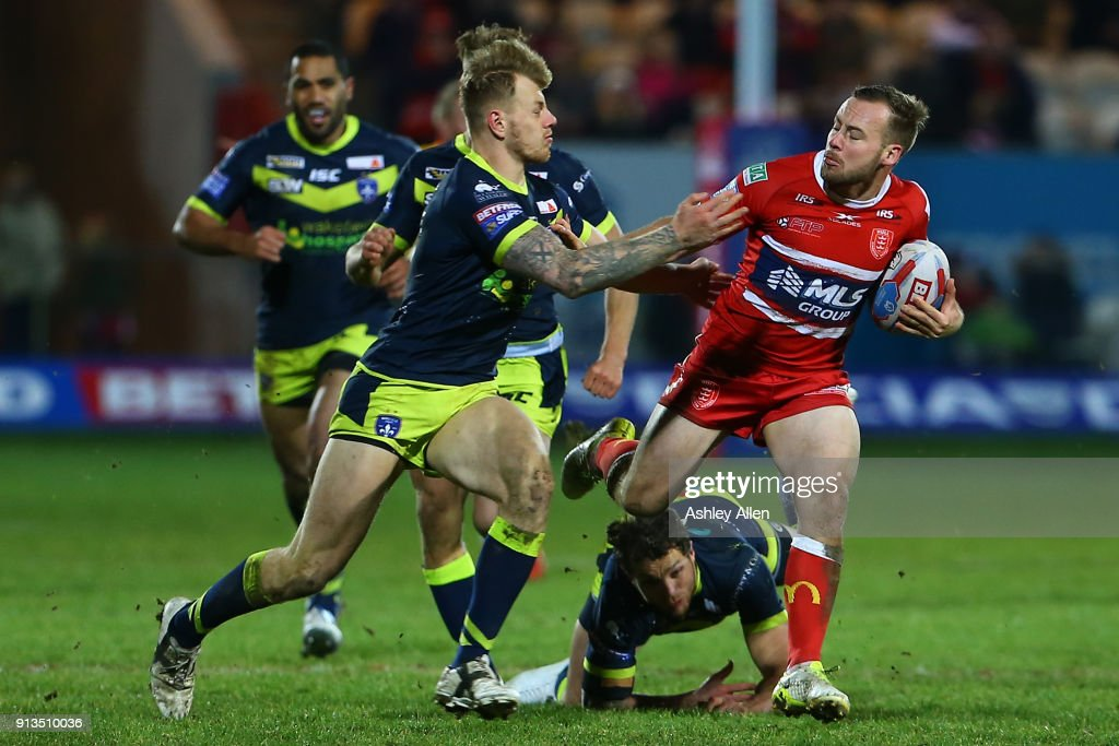 Wakefield Trinity's Tom Johnstone (L) attempts to tackle Hull KR's Adam Quinlan (R) during the BetFred Super League match between Hull KR and Wakefield Trinity at KCOM Craven Park on February 2, 2018 in Hull, England