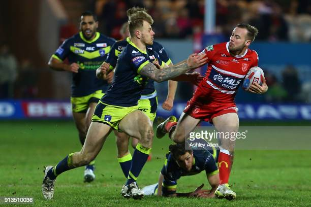 Wakefield Trinity's Tom Johnstone attempts to tackle Hull KR's Adam Quinlan during the BetFred Super League match between Hull KR and Wakefield...