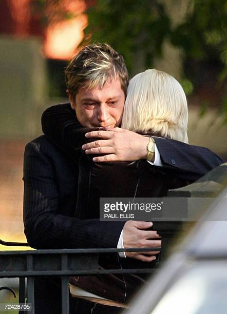 Neil Shepherd embraces his partner Ruth Beatson after the funeral of his children Christianne and Robert Shepherd at St John's Church in Wakefield...
