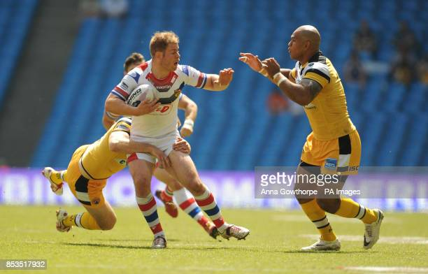 Wakefield Wildcats' Danny Washbrook is tackled by Castleford Tigers' Liam Finn and Jake Webster during the First Utility Super League Magic Weekend...