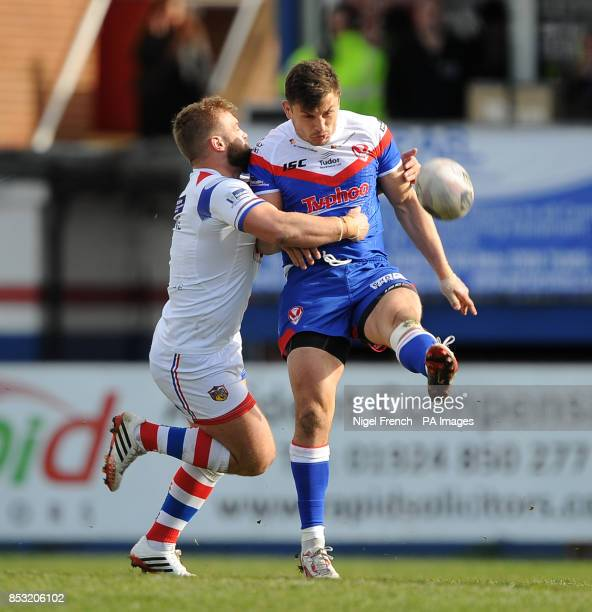 Wakefield Wildcat's Paul McShane tackles St Helen's Jon Wilkin during the First Utility Super League match at The Rapid Solicitors Stadium Wakefield