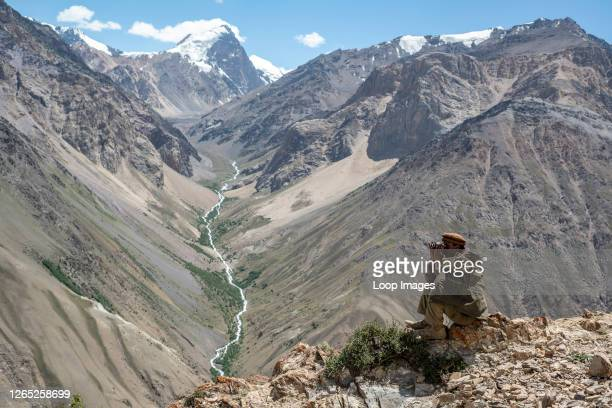 Wakhi man looks out to the mountains in the Wakhan Corridor of Afghanistan.