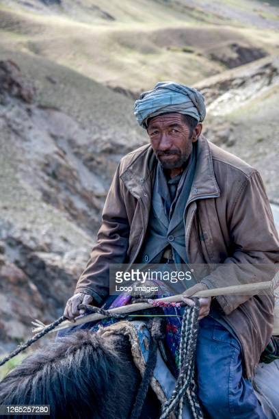 Wakhi man sits astride a yak in the Irshad valley in the Wakhan Corridor of Afghanistan.