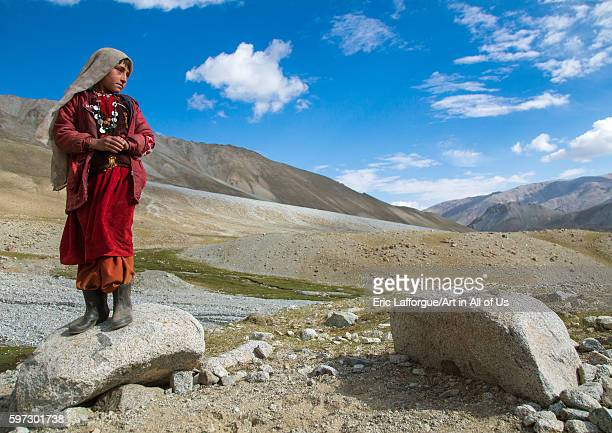 Wakhi nomad girl standing on a rock big pamir wakhan Afghanistan on August 11 2016 in Wakhan Afghanistan