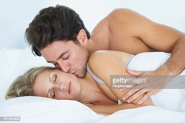 waking her from sleep - good morning kiss images stock photos and pictures