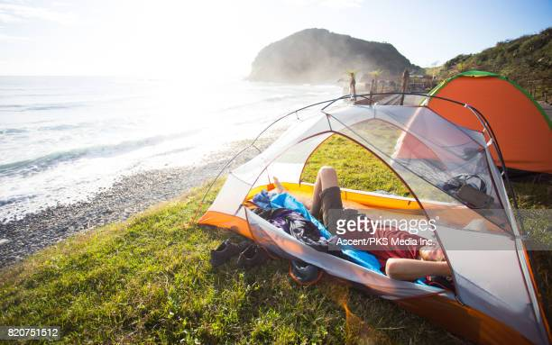 waking up in tent over chinese new years - 25 29 years stock pictures, royalty-free photos & images