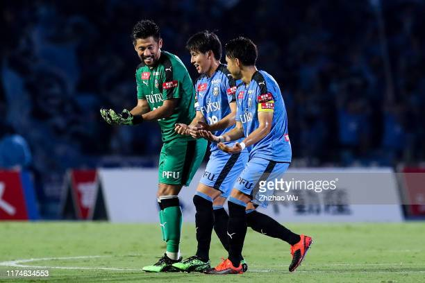 Wakizaka Yasuto of Kawasaki Frontale celebrates his score with teammates Arai Shota and Kobayashi Yu during the J.League J1 match between Kawasaki...