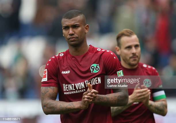 Walace and Marvin Bakalorz of Hannover 96 are disappointed of being relegated after the Bundesliga match between Hannover 96 and SportClub Freiburg...