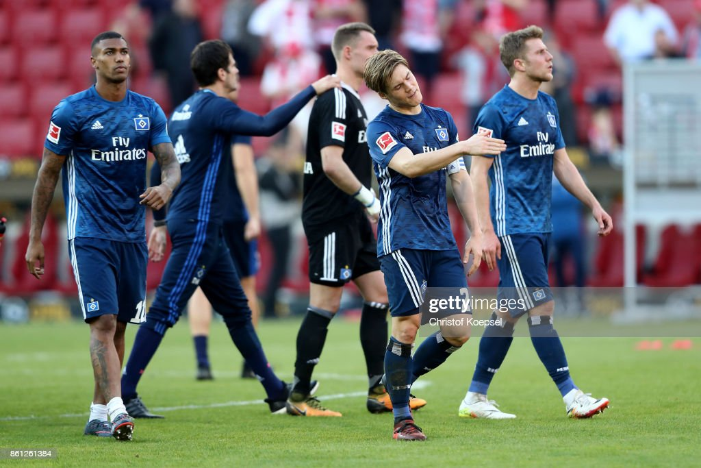 Walace, Gotoku Sakai and Filip Kostic of Hamburger SV look dejected after the Bundesliga match between 1. FSV Mainz 05 and Hamburger SV at Opel Arena on October 14, 2017 in Mainz, Germany. The match between Mainz and Hambnrug edned 3-2.