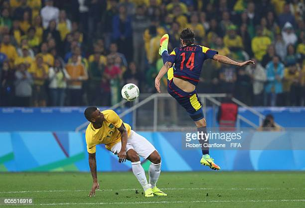 Walace of Brazil and Sebastian Perez of Colombia compete for the ball during the Men's Football Quarter Final match between Brazil and Colombia on...