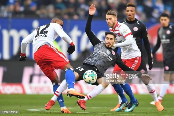 Walace of Hamburg Suat Serdar of Mainz and Aaron Hunt of Hamburg fight for the ball during the Bundesliga match between Hamburger SV and 1 FSV Mainz...