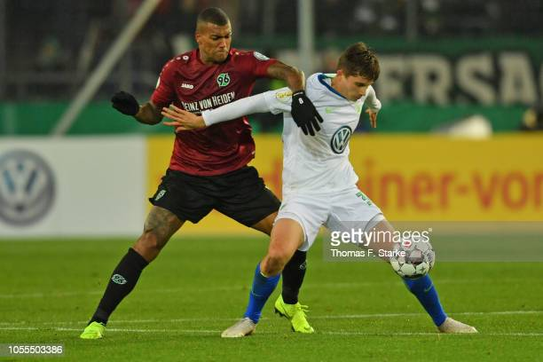 Walace of Hannover and Elvis Rexhbecaj of Wolfsburg fight for the ball during the DFB Cup match between Hannover 96 and VfL Wolfsburg at HDIArena on...