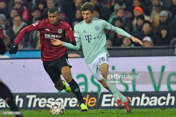Walace of Hannover and Thomas Mueller of Muenchen fight for the ball during the Bundesliga match between Hannover 96 and FC Bayern Muenchen at...