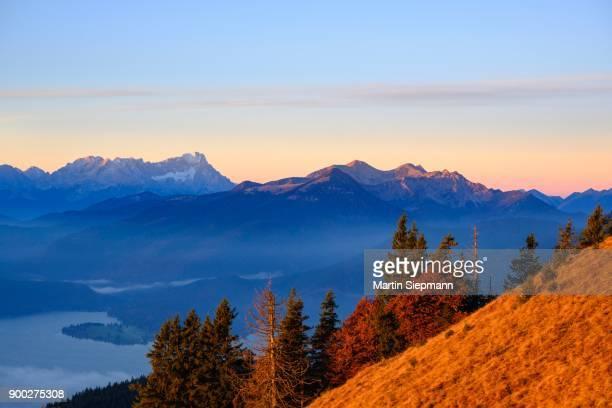 Walchensee, Zugspitze and Krottenkopf in the Estergebirge, view from Hirschhoernlkopf in the morning light, Jachenau, Isarwinkel, Upper Bavaria, Bavaria, Germany