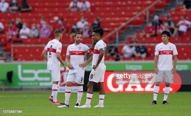 Waldemar Anton, Gonzalo Castro, and Daniel Didavi of VfB Stuttgart look dejected after conceding during the Bundesliga match between VfB Stuttgart...