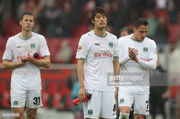 Waldemar Anton Hiroshi Sakai and Edgar Prib of Hannover 96 react after the Bundesliga match between FC Ingolstadt and Hannover 96 at Audi Sportpark...