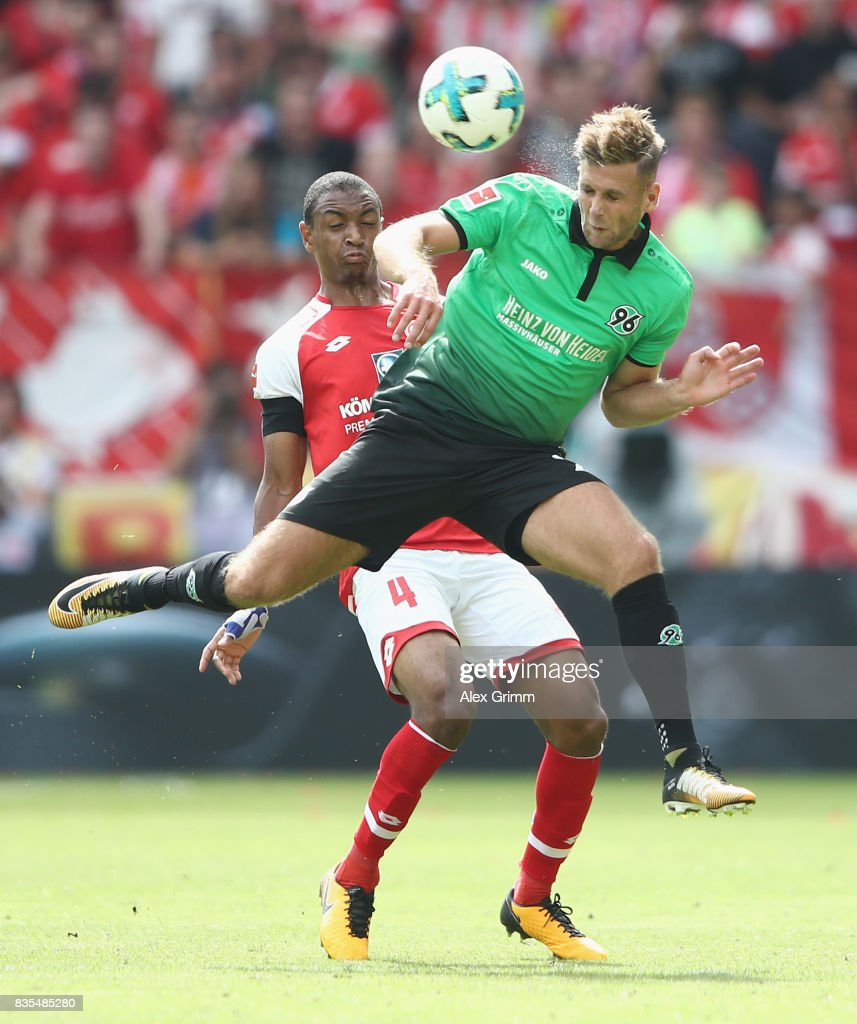 Waldemar Anton (front) of Hannover is challenged by Abdou Diallo of Mainz during the Bundesliga match between 1. FSV Mainz 05 and Hannover 96 at Opel Arena on August 19, 2017 in Mainz, Germany.
