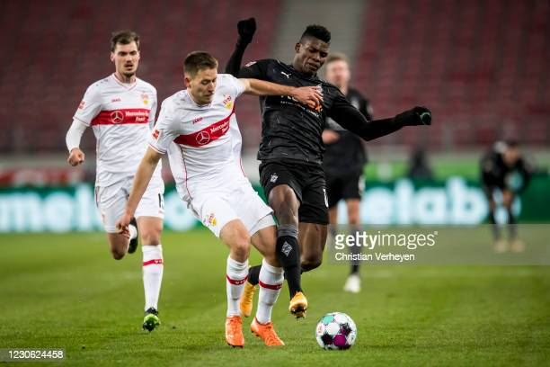 Waldemar Anton of VfB Stuttgart and Breel Embolo of Borussia Moenchengladbach in action during the Bundesliga match between VfB Stuttgart and...
