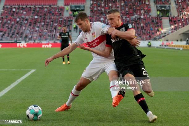 Waldemar Anton of VfB Stuttgart and Florian Wirtz of Bayer 04 Leverkusen battle for the ball during the Bundesliga match between VfB Stuttgart and...