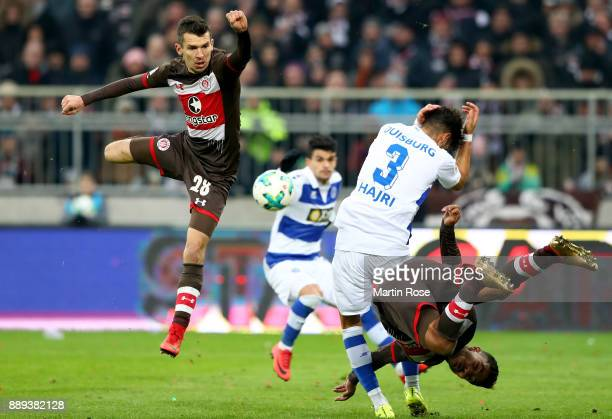Waldemar Sobota ans Sami Allgui of St Pauli and Enis Hajri of Duisburg battle for the ball during the Second Bundesliga match between FC St Pauli and...