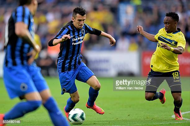 Waldemar Sobota of Club Brugge is challenged by Lebogang Phiri of Brondby IF during the UEFA Europa League, third qualifying round, second leg match...
