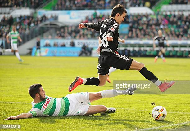 Waldemar Sobota of St Pauli is tackled by Niko Giesselmann of Greuther Furth before the 2 Bundesliga match between Greuther Fuerth and FC St Pauli at...