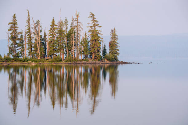 Waldo Lake with heavy smoke in the air due to a wildfire; Willamette National Forest, Oregon.