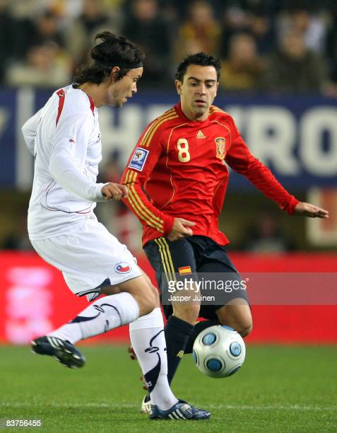 Waldo Ponce of Chile duels for the ball with Xavier Hernandez of Spain during the international friendly match between Spain and Chile at the El...
