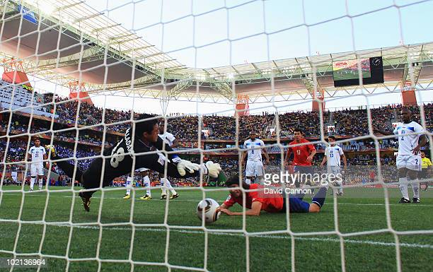 Waldo Ponce of Chile has a header saved by Noel Valladares of Honduras during the 2010 FIFA World Cup South Africa Group H match between Honduras and...