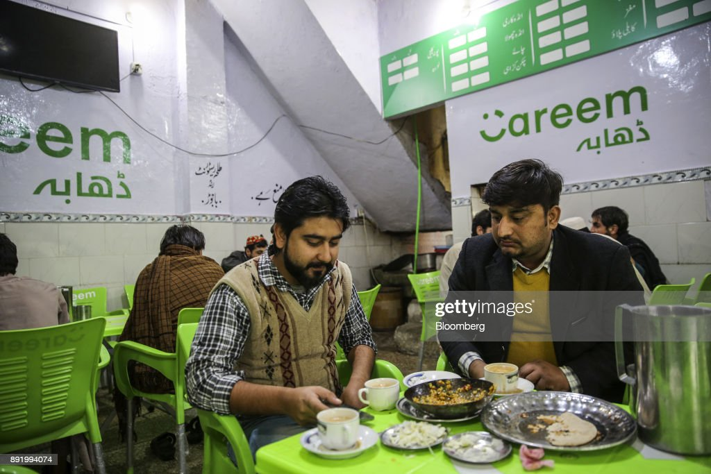 Waleed Ali a Careem Inc driver known as a captain left has lunch at the company`s cafe on Murree Road in Rawalpindi Pakistan on Tuesday Dec 12 2017...