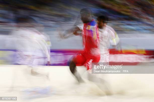 Waleed Beshr and Ahmed Beshr of United Arab Emirates battlof Ecuador for the ball with Alfonso Maquensi of Panama during the FIFA Beach Soccer World...