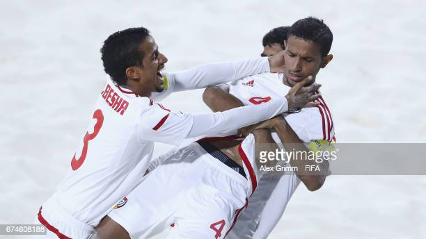 Waleed Beshr of UAE celebrates a goal with team mates Ahmed Beshr and Abbas Ali during the FIFA Beach Soccer World Cup Bahamas 2017 group C match...