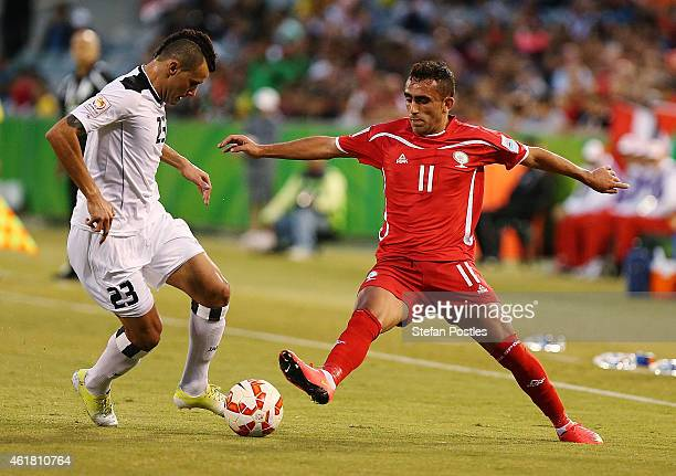 Waleed Salim AlLami of Iraq and Ahmed Wridat of Palestine contest possession during the 2015 Asian Cup match between Iraq and Palestine at Canberra...