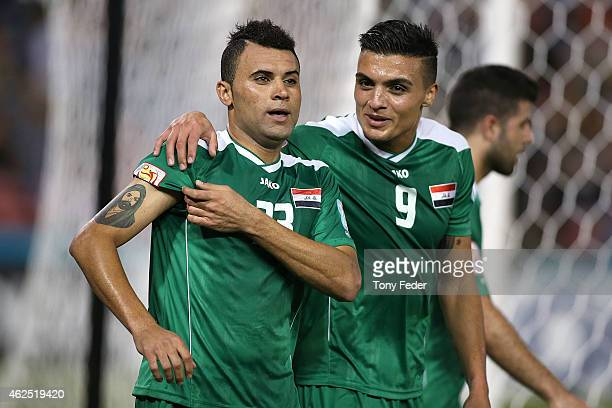 Waleed Salim AlLami of Iraq celebrates a goal with team mate Ahmed Yaseen Gheni during the Third Place 2015 Asian Cup match between Iraq and the...