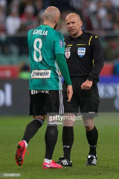 Walerian Gwilia sedzia Szymon Marciniak during the match between Legia Warsaw v Cracovia for the PKO Ekstraklasa in Warsaw Poland on February 29 2020