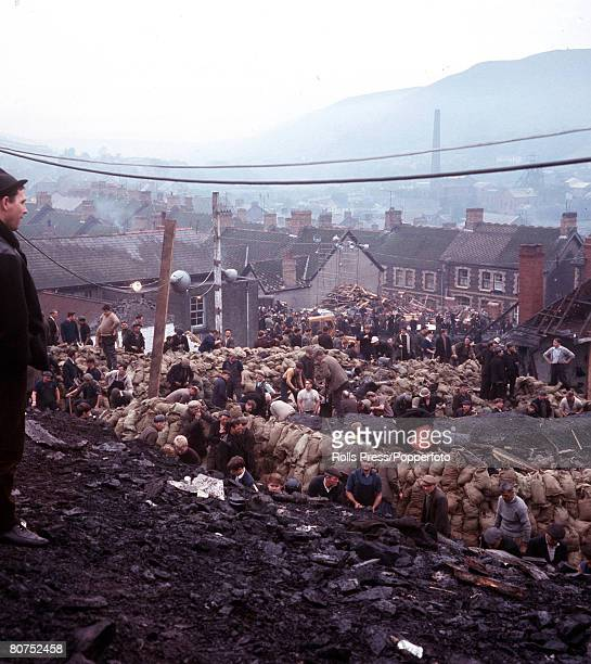 1966 Wales A scene from the Aberfan disaster when a slag heap collapsed onto part of the village killing 144 people Here volunteers help to try and...