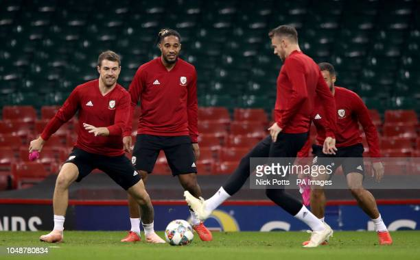 Wales' Aaron Ramsey Ashley Williams and Chris Gunter during the training session at the Principality Stadium Cardiff