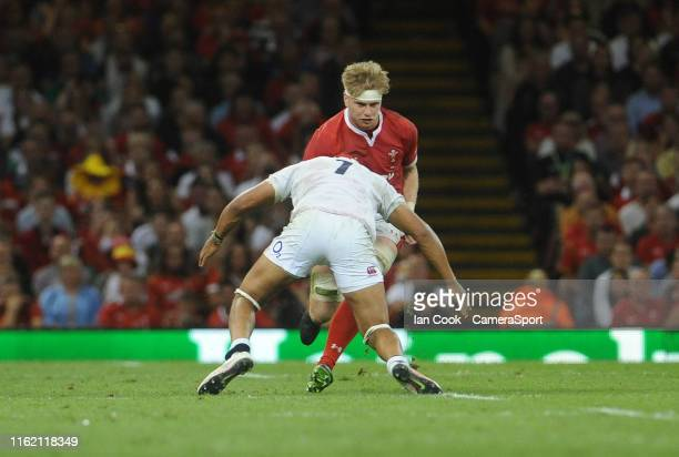Wales Aaron Wainwright takes on Englands Lewis Ludlam during the Under Armour Summer Series match between Wales and England at Principality Stadium...