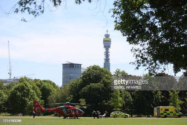 Wales Air Ambulance lands in Regent's Park to transfer a patient to waiting emergency services in London on May 20 as temperatures in the capital are...