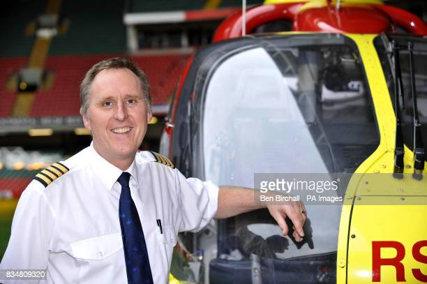 Wales Air Ambulance pilot Pete Cummins stands next to a Eurocopter EC135 that he earlier landed inside the Millennium stadium in Cardiff to mark the...
