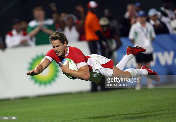 Wales' Aled Thomas scores a try against Argentina during their Rugby World Cup Sevens final match in the Gulf emirate of Dubai on March 7 2009 Wales...