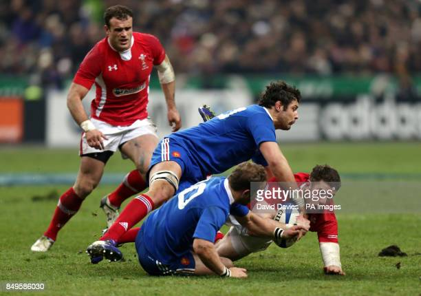 Wales' Alex Cuthbert is tackled by Damien Chouly and France's Frederic Michalak during the RBS 6 Nations match at the Stade de France