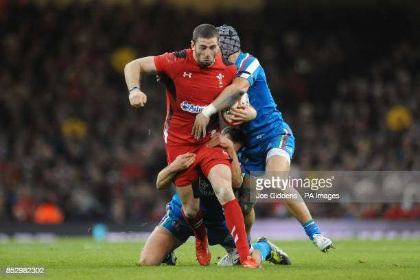 Wales' Alex Cuthbert is tackled by Italy's Mauro Bergamasco and Michele Campagnaro during the RBS 6 Nations match at the Millennium Stadium Cardiff