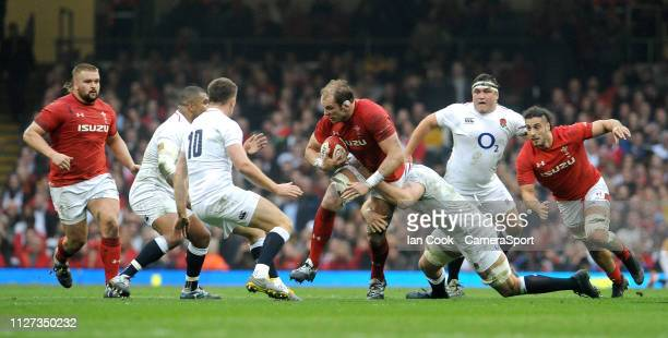 Wales' Alun Wyn Jones is tackled by Englands George Kruis during the Guinness Six Nations match between Wales and England at Principality Stadium on...