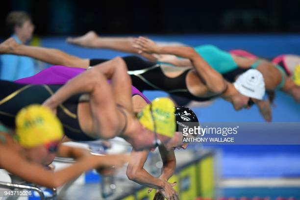 Wales' Alys Thomas jumps off the starting blocks for the swimming women's 200m butterfly final during the 2018 Gold Coast Commonwealth Games at the...