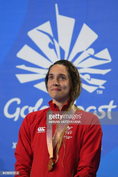 Wales' Alys Thomas poses with her gold medal after winning the swimming women's 200m butterfly final during the 2018 Gold Coast Commonwealth Games at...