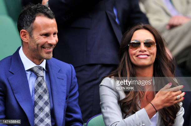 Wales and Manchester United footballer Ryan Giggs and his wife Stacey Cooke in the Royal Box before play on day six of the 2012 Wimbledon...