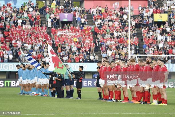 Wales and Uruguay players observe a moment of silence ahead of a Rugby World Cup Pool D match on Oct. 13 in Kumamoto, southwestern Japan, in memory...